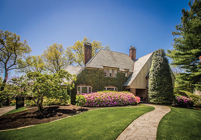 The two-story 1938 Tudor Revival home owned by Amy and Bill Samm.